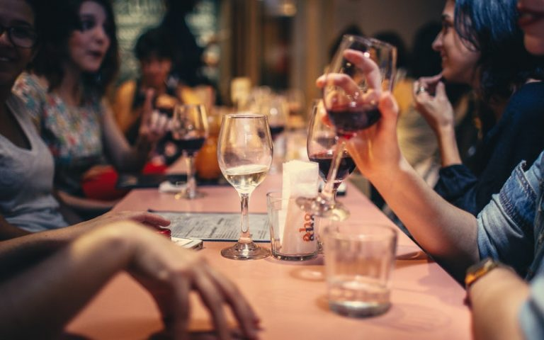 VIN-WINE-drinking-liquor-and-talking-on-dining-table-close-up-696218